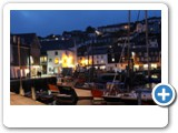Mevagissey at night from along the harbour, an array of restaurants.